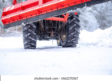 tractor cleans road from snow in the winter