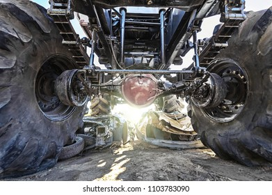 Tractor crush to old car. View from below
