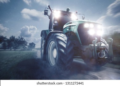 Tractor driving on a dirt road at night