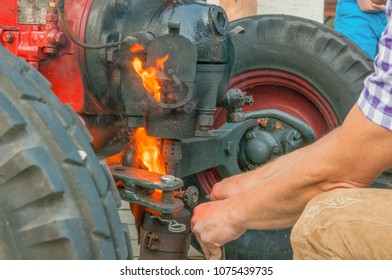 Tractor during preheating and start with an open fire.