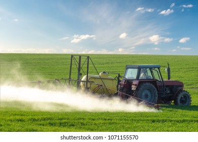 tractor during spraying with herbicides