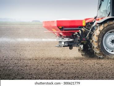 Fertilizer Spreader Images, Stock Photos & Vectors
