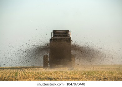 the tractor fertilizes the field with manure. A large trailer. Sowing. Agroindustry.Pole before sowing.