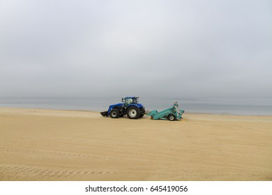 Tractor grading the beach sand, Melbourne