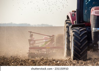 The tractor harvester working on the field