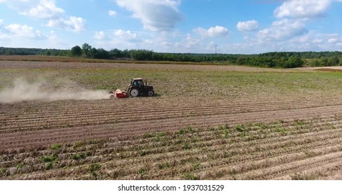 A tractor is harvesting in the field
