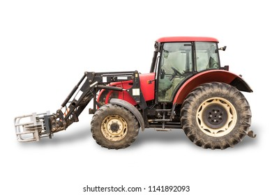 Tractor with hydraulic lift for carrying bales of hay and silage.Isolated foto of the side of the agricultural machine.The equipment for a dairy farm.