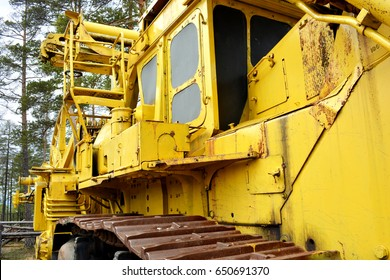 Tractor for laying yellow cables from the left