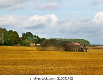 Tractor with  liquid manure on the field.