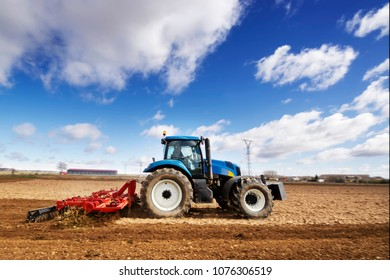 Tractor modern ,  farm equipment in field