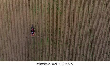 tractor on crop field crop dusting