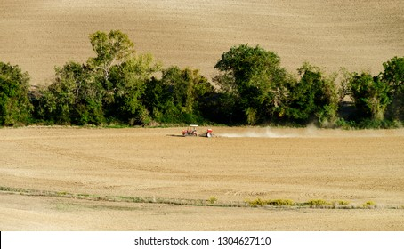 Tractor on the field, Tuscany, autumnal plowing, agricultural concept, Italy
