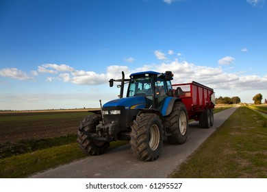 Tractor on the road with trailer