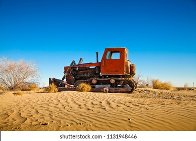 Tractor on the sands of the Kyzylkum desert. Middle Asia (Uzbekistan)