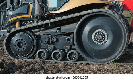 tractor outside with rubber crampons