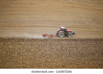 Tractor plowing the field in Tuscany