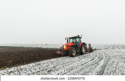 Tractor plowing a field in winter
