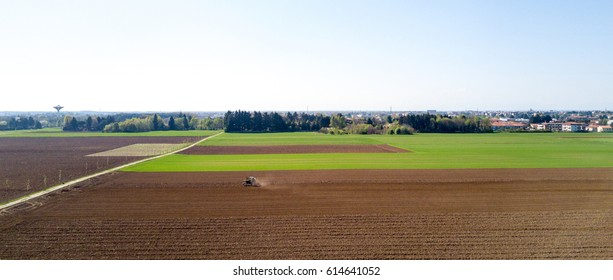Tractor plowing the fields, aerial view, plowing, sowing, harvest. Agriculture and Farming, campaign