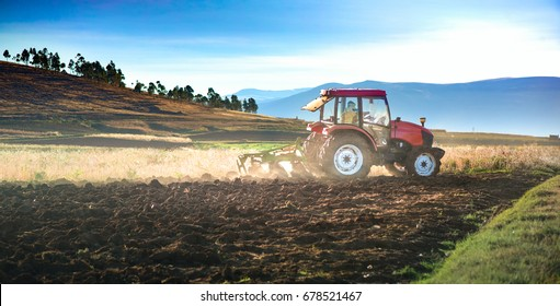 tractor  plowing fields in the andes of Huancayo, Junin, Peru.