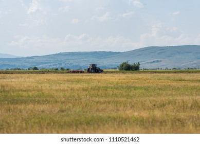 Tractor plowing fields. Preparing land for sowing in autumn.