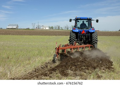 Tractor plowing a wheat field in western Nebraska.