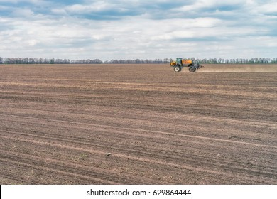 Tractor preparing the field before seeding the ground. Wheat - main crops, which are grown in Ukraine