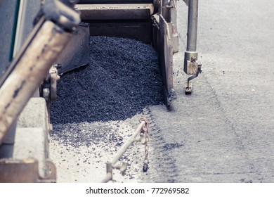 Tractor, roller on the road repair site. Road construction equipment. Road repair concept.