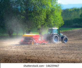 Tractor seeding grains in early spring