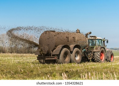 Tractor with slurry tank on the field