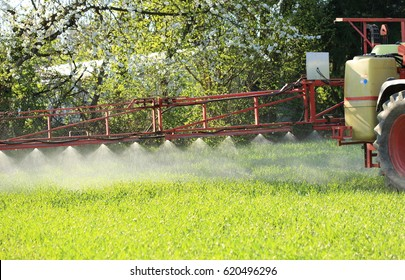 A Tractor spraying agricultural plant protection pesticide