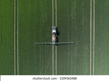 A Tractor Spraying Controversial Glyphosate Herbicide onto Farmland Aerial View