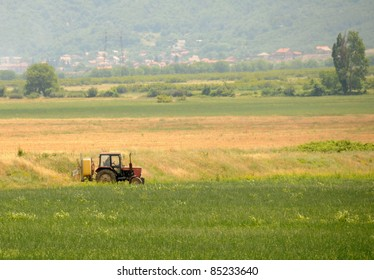 Tractor spraying crops in a field in Bulgaria, Southeast Europe