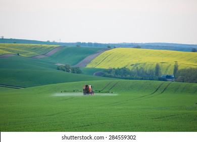 Tractor spraying fields