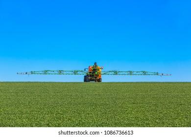 tractor spraying glyphosat on a field
