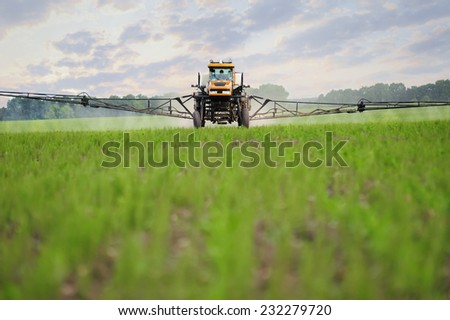 Tractor sprays which protect against pests at a farmer's field