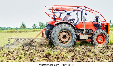 Tractor in Thailand is plowing