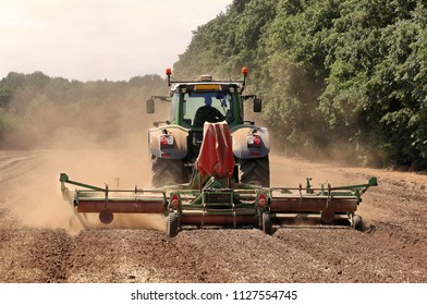 Tractor Tilling a Field and causing a cloud of Dust