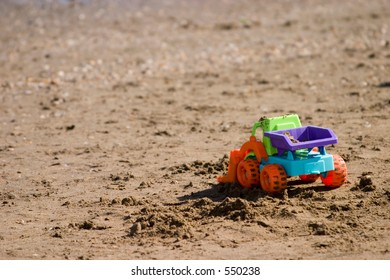 tractor toy on the beach
