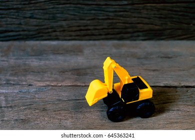 tractor toy on wood background