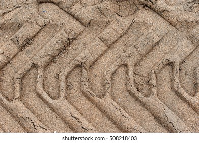Tractor track on sand