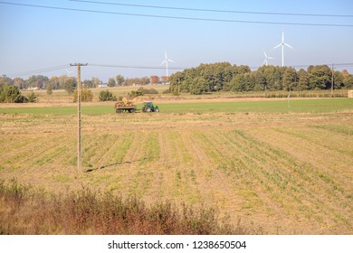 Tractor with trailer in countryside, Poland