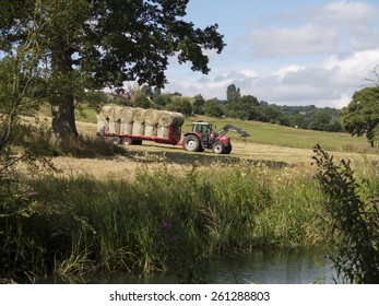a tractor with a trailer of hay in a field near Matlock, Derbyshire, UK. taken 20/07/2014