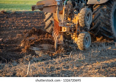 tractor while it is plowing the field