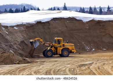 Tractor work in winter opencast