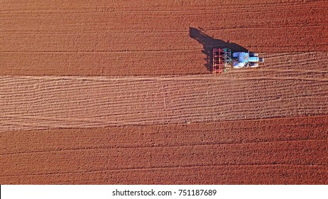 Tractor working the field seen from the air