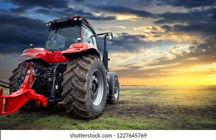 Tractor working on the farm at sunset, a modern agricultural transport, a farmer working in the field, modern tractor closeup