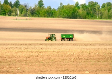 Tractor working on a field on sunny day