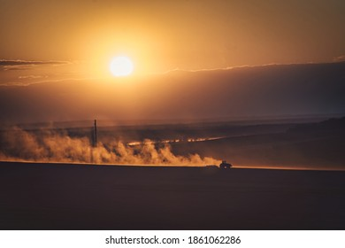 Tractor working on the land. Drought and sunset. - Shutterstock ID 1861062286