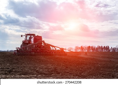 The tractor working on the large field