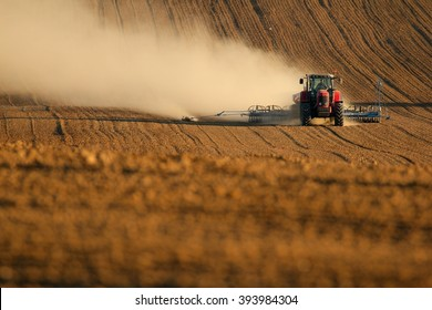 Tractor works in field